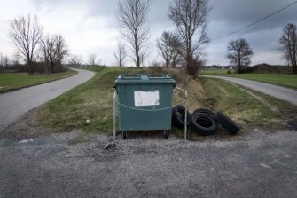 This picture taken on January 23, 2018 shows a trash bin on the side of a road in Vieillevigne.  / AFP PHOTO / ERIC CABANIS        (Photo credit should read ERIC CABANIS/AFP via Getty Images)