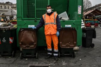 Rashid, a Moroccan garbageman, wearing a face msak, poses at the Porta Palazzo food market on March 16, 2020 in Turin. (Photo by MARCO BERTORELLO / AFP) (Photo by MARCO BERTORELLO/AFP via Getty Images)