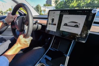 "A picture taken on September 5, 2020 shows an inside view of a ""Tesla Model Y"" car, an all-electric compact SUV by US electric car giant Tesla, during its presentation at the Automobile Club in Budapest. (Photo by ATTILA KISBENEDEK / AFP) (Photo by ATTILA KISBENEDEK/AFP via Getty Images)"