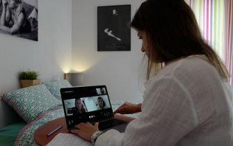 Manon, employee of global PR group Sagarmatha - Hopscotch, connects with her colleagues in Paris via videochat at her home office (teletravail) in the French riviera city of Nice, southern France, on May 15, 2020, a few days after France eased lockdown measures taken to curb the spread of the COVID-19 pandemic, caused by the novel coronavirus. (Photo by VALERY HACHE / AFP) (Photo by VALERY HACHE/AFP via Getty Images)