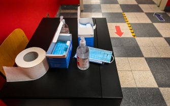 Surgical face masks and hand sanitizer gel are pictured on September 14, 2020 at the start of the school year at the Luigi Einaudi technical high school in Rome, during the the COVID-19 infection, caused by the novel coronavirus. - Schools in some European nations were set to open on September 14, 2020 with millions returning to classrooms in Italy, Greece and Romania. (Photo by Vincenzo PINTO / AFP) (Photo by VINCENZO PINTO/AFP via Getty Images)