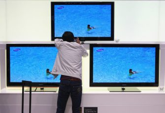 BERLIN - SEPTEMBER 04:  A visitor photographs details of flat-screen televisions at the Samsung stand on opening day at the IFA technology trade fair on September 4, 2009 in Berlin, Germany. The IFA fair is open to the public from September 4-9.  (Photo by Sean Gallup/Getty Images)