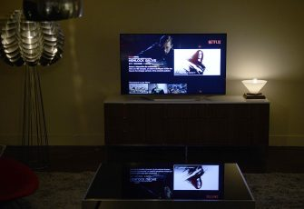 "This photo shows a television screen displaying the French user interface of US online streaming giant Netflix, on September 15, 2014 in Paris. US online streaming giant Netflix will launch the second phase of its European expansion plan on September 15 as it sets about seducing French viewers with a ""House of Cards""-style drama set in Marseille. Netflix's move into the French market will be quickly followed by launches in Austria, Belgium, Germany, Luxembourg and Switzerland, in an offensive that has already put local operators under pressure.AFP PHOTO / STEPHANE DE SAKUTIN        (Photo credit should read STEPHANE DE SAKUTIN/AFP via Getty Images)"