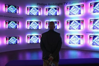 BERLIN, GERMANY - SEPTEMBER 04:  A visitor looks at Ambilight televisions at the Philips stand at the 2015 IFA consumer electronics and appliances trade fair on September 4, 2015 in Berlin, Germany. The 2015 IFA will be open to the public from September 4-9.  (Photo by Sean Gallup/Getty Images)
