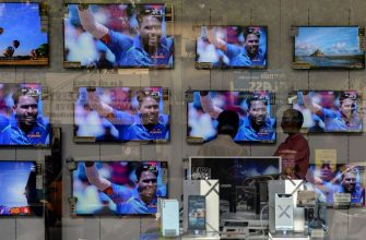 The India-Pakistan cricket final match, taking place in London, is shown on televisions at an electronics showroom in Chennai on June 18, 2017. The Champions Trophy final match between India and Pakistan is taking place at The Oval in London. / AFP PHOTO / ARUN SANKAR        (Photo credit should read ARUN SANKAR/AFP via Getty Images)
