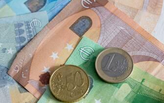 DORTMUND, GERMANY - APRIL 03: (BILD ZEITUNG OUT) In this photo illustration Euro coins on a Euro banknote  are seen on April 03, 2020 in Dortmund, Germany. (Photo by Alex Gottschalk/DeFodi Images via Getty Images)