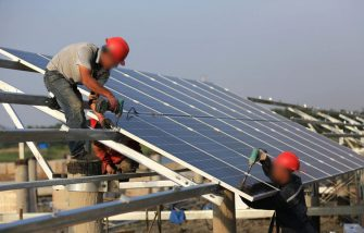 HUAI AN, CHINA - JUNE 11:  Workers install solar panels at the construction site of 40MW photovoltaic on-grid power project of China Huaneng Group on June 11, 2018 in Huai an, China. The first phase with installed capacity of 30 megawatts will be put into operation at the end of June this year.  (Photo by VCG/VCG via Getty Images)