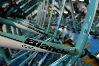 """Bicycles being assembled are displayed in the Bianchi bicycle-making factory on November 26, 2012 in Treviglio. Bianchi, founded in 1885 by Edoardo Bianchi,  is one of the world's oldest cycling maker and its name is associated to the 1940's and 1950's Italian champion Fausto Coppi, nicknamed """"il campionissimo"""" (the champion of champions). F.I.V. Edoardo Bianchi is part of Cycleurope A.B. group since 1997. AFP PHOTO / GIUSEPPE CACACE        (Photo credit should read GIUSEPPE CACACE,GIUSEPPE CACACE/AFP via Getty Images)"""