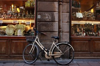 BOLOGNA, ITALY - MARCH 30: A bicycle is parked outside a delicatessen in the historic city center on March 30, 2017 in Bologna, Italy. Cycling is a popular mode of transport in the relatively flat city which sits in the plains of the Po river. (Photo by David Silverman/Getty Images)
