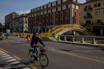 MILAN, ITALY - SEPTEMBER 30: A cyclist rides past the building site of a bike lane part of VenTo, a 679 km cycle path linking Venice to Turin and other major cities of Northern Italy along the banks of the river Po on September 30, 2020 in Milan, Italy. Since the end of lockdown Milan authorities have added a further 35 kilometers of pop-up bike lanes and cycle paths and encouraged cycling and riding e-scooters as a safer form of transport away from jam-packed buses or subway trains, in order to promote social distancing in response to COVID-19. (Photo by Emanuele Cremaschi/Getty Images)