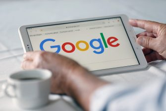 PARIS, FRANCE - SEPTEMBER 10: In this photo illustration, the Google logo is displayed on the screen of a tablet on September 10, 2019 in Paris, France. Yesterday in Washington, DC, fifty state attorneys general are joining together announced the launch of an antitrust investigation against the Google company, accused of dominating all aspects of advertising and Internet search. (Photo by Chesnot/Getty Images)