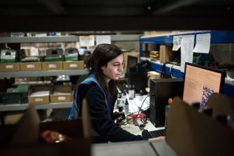 An employee works in the e-commerce section of a depot of The NX Group, a company offering secure warehousing, UK distribution & same day courier services, in Crick near Rugby, central England on January 7, 2019. - The NX Group have seen an increase in demand of their services which they ascribe in part to the potential of a 'no deal' outcome in Britain's departure from the European Union (Brexit). (Photo by Oli SCARFF / AFP)        (Photo credit should read OLI SCARFF/AFP via Getty Images)