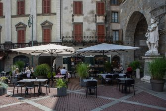 BERGAMO, ITALY - JUNE 18: People have lunch at a restaurant at a social distance on June 18, 2020 in Bergamo, Italy. The city of Bergamo is slowly returning to normality after the lockdown for Covid-19 pandemic.  (Photo by Emanuele Cremaschi/Getty Images)