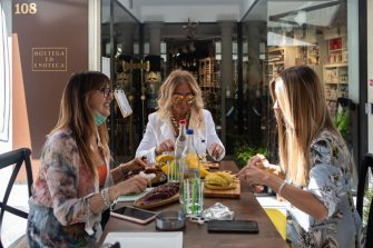 BERGAMO, ITALY - JUNE 18: Three women have lunch at a restaurant in the Lower Town on June 18, 2020 in Bergamo, Italy. The city of Bergamo is slowly returning to normality after the lockdown for Covid-19 pandemic.  (Photo by Emanuele Cremaschi/Getty Images)