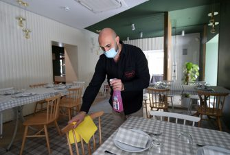 SALERNO, ITALY - MAY 21: Donato Luongo, owner of Trattoria Da Sasà, taking measures for social distancing in his restaurant on May 21, 2020 in Salerno, Italy. Restaurants, bars, cafes, hairdressers and other shops have reopened, subject to social distancing measures, after more than two months of a nationwide lockdown meant to curb the spread of Covid-19