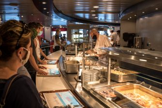AT SEA, ITALY - AUGUST 7: Passengers are served lunch at the restaurant of a passenger ship sailing from Greece to Italy on August 7, 2020 at sea near Italy. Passenger ships resume sailings more than three months after they were suspended due to coronavirus travel restrictions. (Photo by Siegfried Modola/Getty Images)