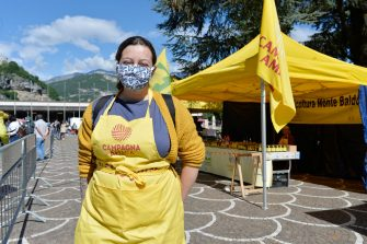 TRENTO, ITALY - MAY 02:  A farmer wearing a face mask poses in front of his stall in a newly re-opened vegetable open-air market during the coronavirus pandemic on May 02, 2020 in Trento, Italy. Italy will remain on lockdown to stem the transmission of the Coronavirus (Covid-19), slowly easing restrictions. (Photo by Alessio Coser/Getty Images)