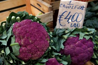 CATANIA, ITALY - SEPTEMBER 26: Heirloom cauliflowers, Cavolfiore in Italian, on sale for 4 Euro each at a produce stall as La Pescheria, the local fish market, on September 26, 2017 in Catania on the Italian island of Sicily. With the island's famous Etna volcano looming over the city, the market fills the streets behind the Piazza del Duomo every workday morning, with a wide assortment of freshly caught local fish, swordfish and shellfish, along with Sicilian staples such as roasted vegetables, fresh produce, cheeses and meats. (Photo by David Silverman/Getty Images)