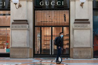 MILAN, ITALY - JUNE 02: A tourist rides a segway hoverboard as he passes in front of a Gucci store on June 02, 2020 in Milan, Italy. Many Italian businesses have been allowed to reopen, after more than two months of a nationwide lockdown meant to curb the spread of Covid-19. (Photo by Roberto Finizio/Getty Images)