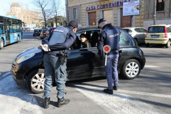 ROME, ITALY - MARCH 15: A Police patrol of the Ostia Commissariat checks if the occupants of a car are respecting the quarantine on March 15, 2020 in Rome, Italy. Ostias streets, one of Rome neighborhood were eerily quiet on the forth day of a nationwide quarantine. The Italian Government has taken the unprecedented measure of a nationwide lockdown by closing all businesses except essential services such as, pharmacies, grocery stores, hardware stores, tobacconists and banks, in an effort to fight the world's second-most deadly Coronavirus (COVID-19) outbreak outside of China.The movements in the streets are allowed only for work reasons and health reasons proven by a medical certificate. Citizens are encourage to stay home and have an obligation to respect the safety distance of one meter from each other in a row at supermarkets or in public spaces. According to the Ministry of the Interior, of the over half a million people controlled by the police in the past four days, over 20 thousand people have been reported for violating the quarantine.  (Photo by Marco Di Lauro/Getty Images)