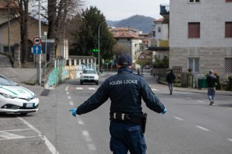 PONTE SAN PIETRO, ITALY - MARCH 27: A Local Police officer stops a car at a checkpoint on March 27, 2020 in Ponte San Pietro, near Bergamo, Northern Italy. Bergamo and its nearby towns are the epicenter of Italyâ  s hardest-hit region, Lombardy, the site of hundreds of coronavirus deaths. The Italian government continues to enforce the nationwide lockdown measures to control the spread of COVID-19. (Photo by Emanuele Cremaschi/Getty Images)