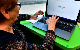 "An elderly person uses a computer during a computer workshop in the ""digital bus (""bus numerique"") in Villandraut, near Sauternes, southwestern France, on May 22, 2018. - The ""digital bus (""bus numerique"") has been launched by the CARSAT (French Pension insitution - Caisse d'assurance retraite et de la sante au travail) of Aquitaine region at the end of 2016 to promote computer and internet access for elderly people. (Photo by GEORGES GOBET / AFP)        (Photo credit should read GEORGES GOBET/AFP via Getty Images)"