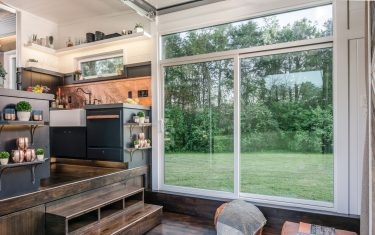 THIS STUNNING tiny 28-foot-long house could be a solution to the housing crisis using a space-saving design without losing any home comforts. Incredible images and video footage show the elegant and surprisingly spacious home which features two bedrooms including a seven and a half foot gooseneck master bedroom as well as all the luxury one might be accustomed to with solid walnut flooring, Custom Shoji Paper sliding doors and porcelain countertops. Other striking shots show the exterior of the tiny home with large windows include to provide plenty of natural light while the main window opens up like a garage door to act as an entrance. The creative design is the work of New Frontier Tiny Homes who remained their popular flagship model The Alpha into a more elegant, spacious family home to create The Escher. New Frontier Tiny Homes / mediadrumworld.com (New Frontier Tiny Homes / mediad / IPA/Fotogramma,  - 2017-10-13) p.s. la foto e' utilizzabile nel rispetto del contesto in cui e' stata scattata, e senza intento diffamatorio del decoro delle persone rappresentate