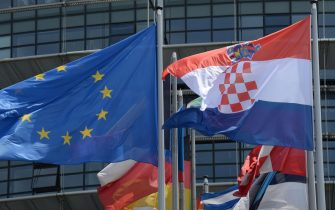 epa03771264 The Croatian flag (R) flies next to European flags outside the European Parliament in Strasbourg, France, 02 July 2013. Following the successful ratification of its European Union Accession Treaty by the national parliaments of the 27 Member States, the Republic of Croatia has joined the EU as the 28th member on 01 July 2013.  EPA/PATRICK SEEGER