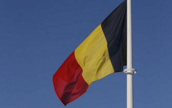 epa05731102 Belgium flag flies near a wind farm outside Perwez, Belgium, 19 January 2017. Due to freezing temperature, high pressure, low winds and problems at some nuclear plants in Belgium and France, Belgium is close to activating their strategic reserves.  EPA/OLIVIER HOSLET
