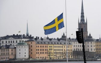 epa05900906 A Swedish flag at half mast at the official ceremony at Stockholm City Hall, in Stockholm, Sweden, 10 April 2017. The members of the Swedish Royal family are joining politicians and members of the public for a one minute of silence at the official ceremony, at noon, to remember the victims of the terror attack on Drottninggatan, Stockholm, 07 April 2017.  EPA/ANDERS WIKLUND  SWEDEN OUT
