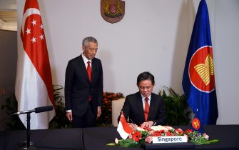 epa08821161 A handout photo made available by Singapore's Ministry of Communications and Information (MCI) shows Prime Minister Lee Hsien Loong (L) and Trade and Industry Minister Chan Chun Sing attending the 4th Regional Comprehensive Economic Partnership (RCEP) Summit and Signing Ceremony via video conference in Singapore, 15 November 2020. Fifteen Asia-Pacific nations signed the Regional Comprehensive Economic Partnership (RCEP) on 15 November, the world's largest free trade deal at the end of an annual summit of Southeast Asian leaders and regional partners.  EPA/MCI HANDOUT  HANDOUT EDITORIAL USE ONLY/NO SALES