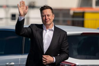 epa08643377 Tesla and SpaceX CEO Elon Musk waves while arriving for a statement at the construction site of the Tesla Giga Factory in Gruenheide near Berlin, Germany, 03 September 2020. Musk visited the German medical company Curevac in Tuebingen on 01 September 2020. Media report Musk will meet the German Economy Minister for talks. In June 2020, the German state invested 300 million euros in the vaccine developer Curevac and received 23 percent of the company's shares in return.  EPA/ALEXANDER BECHER