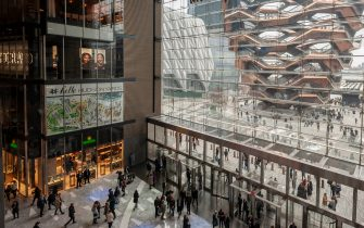 The Vessel is seen from the lobby of the Hudson Yards mall on the West Side of Manhattan on its grand opening day, Friday, March 15, 2019. Retailers, including the Neiman Marcus department store, opened their shops in the development which was built on a platform over the West Side railroad yards. Office, residential, public space and retail space comprise the first phase in what is arguably the most expensive construction project ever built in the U.S.   (Photo by Richard B. Levine) (New York - 2019-03-15, Richard B. Levine / IPA) p.s. la foto e' utilizzabile nel rispetto del contesto in cui e' stata scattata, e senza intento diffamatorio del decoro delle persone rappresentate