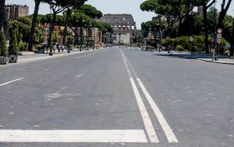 Roma in zona gialla, sullo sfondo il Colosseo