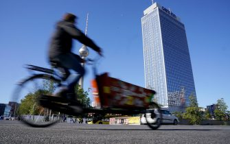 epa07860489 A cyclist rides a cargo bike near the TV tower during the Car-Free Day in Berlin, Germany, 22 September 2019. During the 18th edition of EUROPEANMOBILITYWEEK, the European Commissionâs flagship campaign promotioned clean and sustainable urban transport. Running from 16-22 September 2019, almost 3,000 towns and cities from about 50 countries joined with their activities promoting safe walking and cycling. EUROPEAN MOBILITY WEEK culminates each year in the Car-Free Day, when streets close for traffic and open for people.  EPA/ALEXANDER BECHER