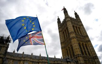epa08902634 (FILE) EU flags fly during a demonstration outside the British Houses of Parliament in Westminster, central London, Britain, 03 September 2019 (reissued 24 December 2020). A historic deal on the UK s future trading and security relationship with the European Union has been agreed upon 24 December 2020, a week before the end of the Brexit transition period.  EPA/NEIL HALL *** Local Caption *** 55438883