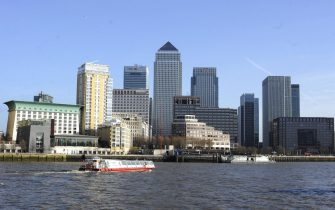 epa06299601 (FILE) - A boat passes by Canary Wharf, part of London's financial district, in London, Britain, 31 January 2013. The BBC said in a report on 31 October 2017 that the Bank of England is expecting up to some 75,000 finance industry jobs could be lost during the years that follow Britain's expected departure from the European Union. BBCs economics editor Kamal Ahmed wrote that the Bank of England may be using the figure as a 'reasonable scenario', especially if EU and UK would not be able to reach a deal on financial services.  EPA/FACUNDO ARRIZABALAGA
