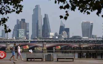 epa08599379 A general view of the skyline and high-rise buildings in London, Britain, 12 August 2020. According to news reports, the UK is now officially in recession. Britain is set to experience its worst recession on record after data showed the Coronavirus sent the UK economy plunging by over twenty percent for the second quarter of 2020.  EPA/ANDY RAIN