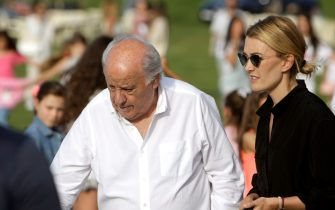 epa07727948 Inditex founder Amancio Ortega (C) and daughter Marta Ortega (R) attend the opening of the 38th International Jumping Competition in A Coruna, northwestern Spain, 19 July 2019. The competition will take place in summer at Casas Novas' hippodrome.  EPA/Cabalar