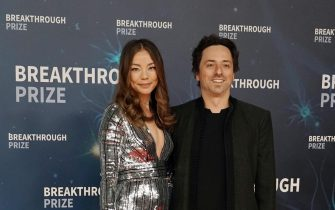 epa07971062 Sergey Brin, Breakthrough Prize Co-Founder and Co-Founder of Google (R) and his wife Nicole Shanahan (L) pose on the red carpet before the eighth annual Breakthrough Prize Awards, held at the NASA Ames Research Center in Mountain View, California, USA, 03 November 2019. The Breakthrough Prize is awarded annually, and recognizes the world's top scientists. Considered the world's most generous science prize, each Breakthrough Prize is three million US dollar and presented in the fields of Life Sciences (up to four per year), Fundamental Physics (one per year) and Mathematics (one per year).  EPA/MONICA M. DAVEY