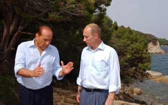 Italian Prime Minister Silvio Berlusconi (L) gestures speaking with Russian President Vladimir Putin (R) as they walk at Berlusconi's Villa Certosa in a suburb of Porto Rotondo, one of Sardinia's most fashionable resorts, Friday 29 August 2003. The leaders are going to discuss a wide range of questions including military and military industrial cooperation. EPA PHOTO/ITAR-TASS POOL/PRESIDENTIAL PRESS SERVICE/PRESIDENTIAL PRESS SERVICE / ITAR-TASS POOL/