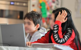 Children from a large family are in distance learning (DAD, 'didattica a distanza') amid the Covid-19 Coronavirus pandemic, in Milan, Italy, 05 March 2021. COVID-19 contagion has been rising sharply in Italy after the arrival of new, more contagious variants of the virus, including the British one, which has become the predominant form.  ANSA/ ANDREA FASANI