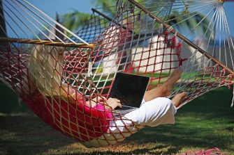 TRIVANDRUM, INDIA - JANUARY 12:  Woman lying in a hammock and working with a notebook on January 12, 2010 in Varkala near Trivandrum, Kerala, India. (Photo by EyesWideOpen/Getty Images)