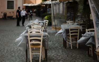 Wind moves the tablecloths of the tables of a deserted restaurant in Trastevere district as Italy is facing a surge in the coronavirus disease (COVID-19) infections in Rome, Italy, October 26, 2020. Italian government decided new nationwide Covid-19 restrictions that come into effect on 26 October, and include the closure of restaurants and bars by 6pm and shutting down gyms, cinemas and swimming pools. According to Ministry of Health there has been 17,012 infections from Covid-19 in the last 24 hours out of 124,686 tampons carried out. 141 deaths and 76 additional patients admitted to intensive care units. (Photo by Christian Minelli/NurPhoto via Getty Images)