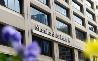 NEW YORK, UNITED STATES - MAY 21:  Standard&Poor's, biggest credit rating institution of the world, is seen on the photo in New York, United States on 21 May, 2014. Leading financial institutions of country are present at Wall Street and they are regarded as not only USA's crucial economic points but also heart of the world economy. They dominate the economic situation of country with their decisions and statement of numbers. (Photo by Cem Ozdel/Anadolu Agency/Getty Images)