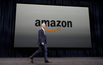 epa06996692 (FILE) - A file photograph showing Amazon CEO Jeff Bezos walking on stage at a press conference where he introduced new Kindle products such as the Kindle Paperwhite Wi-Fi + 3G, the Kindle Fire HD and new programs and innovations for the wireless tablets at Santa Monica Airport in Santa Monica, California, USA, 06 September 2012 (issued 04 September 2018). Amazon.com Inc. has become the second publicly traded US company to reach one trillion US dollars in market value. Last month Apple Inc. was the first company to be valued at 1 trillion US dollars.  EPA/MICHAEL NELSON