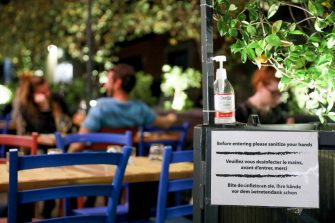 A bottle of hand sanitizing gel near customers dining in a restaurant in Rome, Italy, on Thursday, Oct. 22, 2020. Italy reported record new coronavirus infections on Wednesday as Rome and Milan, the country's political and financial capitals, prepare for a night-time curfew. Photographer: Alessia Pierdomenico/Bloomberg via Getty Images