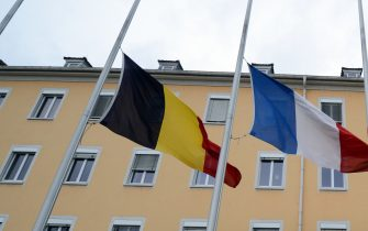 The flags of Belgium, France, Spain, and Germany (l-R) wave at half mast in front of the Robert Schuman Barracks of the German-French Brigade in Muellheim,Germany, 08 January 2015. Twelve people were killed in Paris on Wednesday, 07 January 2015, after an attack on the satirical magazine 'Charlie Hebdo.' Photo:PATRICKSEEGER/dpa