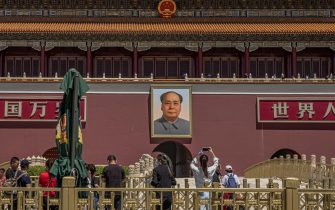 epa09246641 People visit the area next to the Chairman Mao portrait on the south gate of the Forbidden City, in front of Tiananmen Square, on the day of 32nd anniversary of the 1989 Tiananmen Square massacre, in Beijing, China, 04 June 2021. Between 15 April and 04 June 1989, students, intellectuals, and activists engaged in a series of demonstrations against the Chinese Communist Party that ended with a violent military crackdown, with many civilians' deaths and injuries. Since then, no official death toll has been released by Chinese officials. However, rights groups estimate hundreds, if not thousands, were killed, with many others jailed in a subsequent purge. The Tiananmen Square protest remains one of the most widely censored topics in China.  EPA/ROMAN PILIPEY