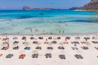 Aerial view from a drone of Balos Beach, the incredible lagoon with the turquoise exotic and tropical water of the Mediterranean sea  is located in Chania region in Crete Island. Balos is one of the most visited beaches in Crete and popular for visitors around the world. Crystal clear water, the lagoon, rocky steep mountains, a beach bar providing umbrellas and shadow with beverages and a pirate island are located at the same region that is accessible by a 20 min trek or boat. Greece is trying to boost its tourism and give privileges to vaccinated against Covid-19 Coronavirus pandemic international tourists and locals, as the country is heavily depended from the tourism industry. Balos, Chania, Greece on June 13, 2021 (Photo by Nicolas Economou/NurPhoto via Getty Images)